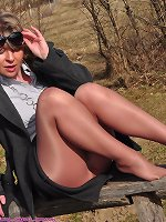 Angel in Boots and Shiny Pantyhose outside
