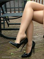 Amy simply loves shoes ike this. The very high thin tapered heel is nice and curvy to match her perfect figure. While the shiny patent leather reflects the very essence of her sexual nature