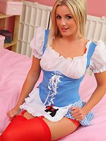 Stunning Amy Green in maids outfit and red suspenders