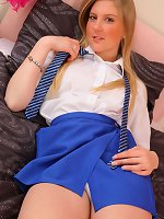 Naughty blonde college girl slips out of her college uniform.
