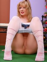 Angel in pantyhose over heels gives a guy a lustful footjob