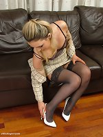 Cute babe Faye in silky smooth black nylons and pointy white stilettos