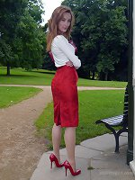 Hot red head Sophia steps out the office on her lunch break to parade around the park in a sexy blouse, red skirt and killer red stiletto heels