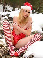 Beautiful Santa Claus girl seductively removes her sexy outfit