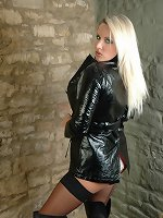 Cute blonde Dannii Harwood is dressed in this very kinky short and shiny black leather jacket. And you know Dannii has a real fetish for leather, and the feel of it against her naked body makes her so horny