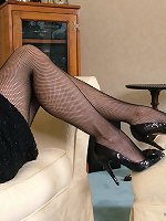 Sexy posh Vicky loves showing off her fishnets and sparkling black heels