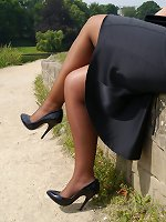 Lovely Karen is on her break and enjoying a bit of sunshine in her silky nylons and her black high heel shoes
