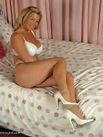 White lingerie and matching high heels make this beautiful blonde look so good