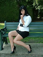 Dark haired office babe Nicola goes for a stroll round the park at lunch, to show off her short black shirt and tall stiletto shoes